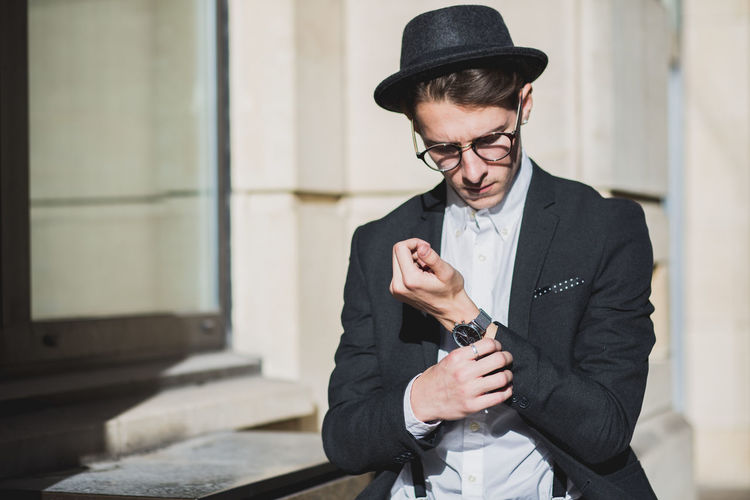 Man dressed smart with hat and glasses in city. Adult Adults Only Blazer Braces Business City City Life Day Fashion Fashion Fashion Photography Glasses Hat Hat Jacket Men One Person People Shirt Smart Stylish Suit Walking Watch Young Adult The Modern Professional