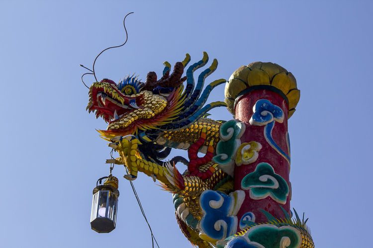 Dragon statue in Chinese temple Chinese Dragon Statue Dragon In Chinese Temple Animal Representation Architecture Art And Craft Belief Chinese Dragon Craft Creativity Dragon Dragon Statue Dragon Statues Festival Multi Colored No People Ornate Outdoors Religion Representation Sculpture Statue