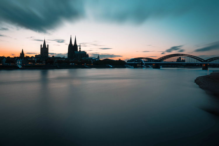 Cologne Architecture Bridge Bridge - Man Made Structure Building Building Exterior Built Structure City Cityscape Cloud - Sky Connection Dusk Gamescom Germany Illuminated Long Exposure Nature No People Outdoors River Sky Sunset Travel Destinations Water Waterfront