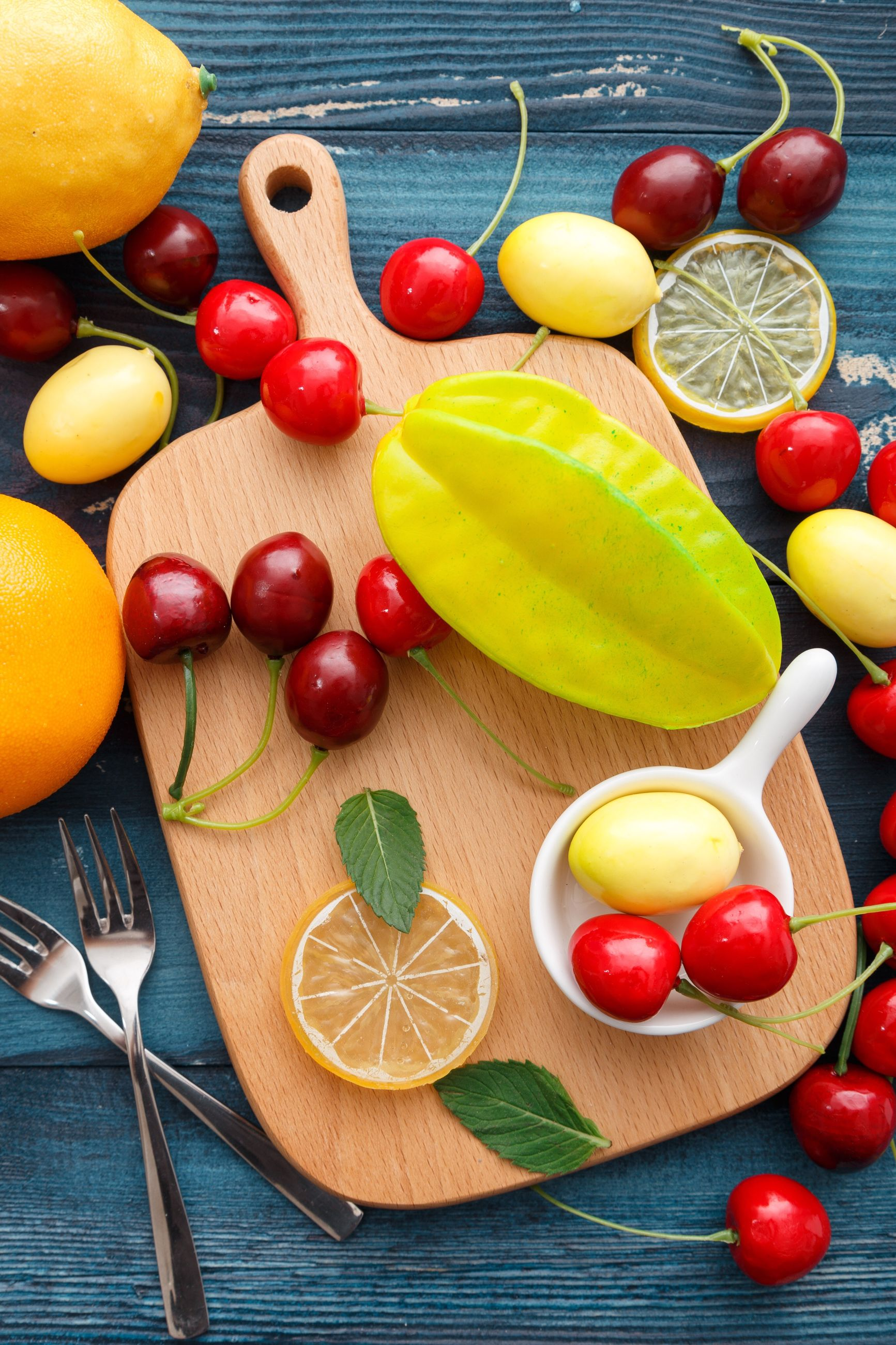 food and drink, freshness, healthy eating, still life, food, high angle view, indoors, variation, no people, table, wood - material, fruit, vegetable, tomato, leaf, wooden spoon, close-up, day