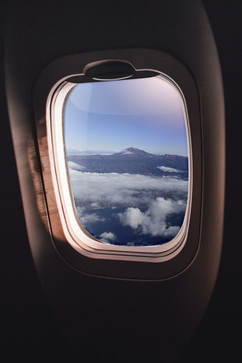 View of cloudy sky seen through airplane window