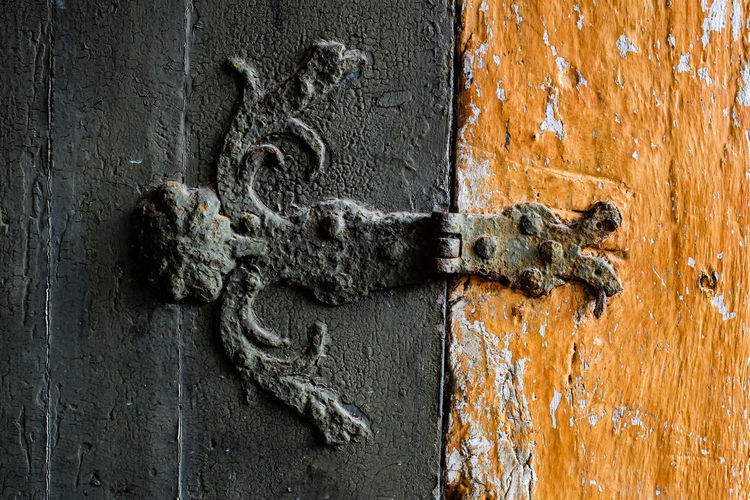 Rusty Hinge On Door And Wall