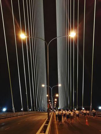 EyeEmNewHere Rama8 Rama8bridge Runingevent City Illuminated Cityscape Suspension Bridge Road Bridge - Man Made Structure Light Trail Long Exposure Car Sky Roadways Cable-stayed Bridge