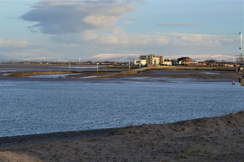 Knott End on Sea ferry slipway and The Waterfront Apts with snowcapped hills of the Pennines in the background - as viewed from Fleetwood Esplanade. Water Sky Built Structure Cloud - Sky Architecture Nature Land Beach Sea Day Building Exterior Scenics - Nature No People Outdoors Beauty In Nature Sport Tranquil Scene Sand Tranquility Knott End On Sea Fleetwood Lancashire Snow
