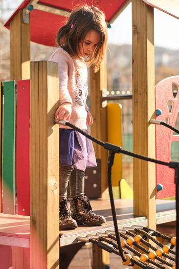 Full length of girl standing outdoors