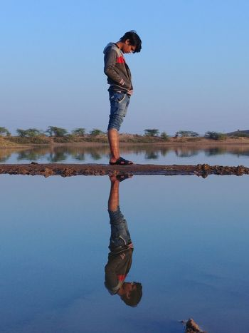 Reflection Water Reflections Upside Down Up Down Reflection One Person Water Full Length Young Adult Adult Adults Only People Sky Standing Men Outdoors One Man Only Day Nature