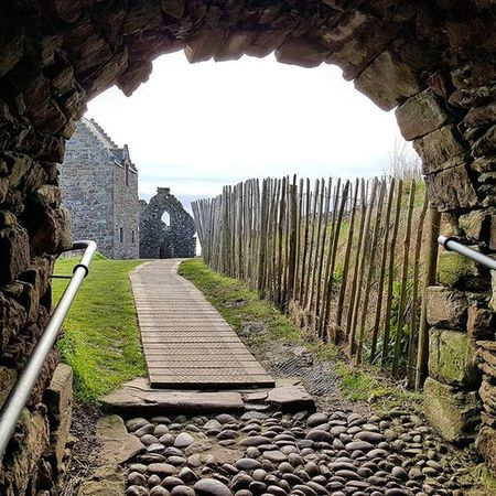 Path to the Chapel - Nice framing and leading lines towards the Chapel. Dunnottarcastle Dunnottar Tunnel Chapel Rustic Texture Beautiful Leadinglines Fence Sunshine Spring Coastline Castle Stonehaven Beautifulscotland Visitaberdeen Visitaberdeenshire VisitScotland Brilliantmoments Photooftheday Landscape @visitscotland Britains_talent SamsungS6