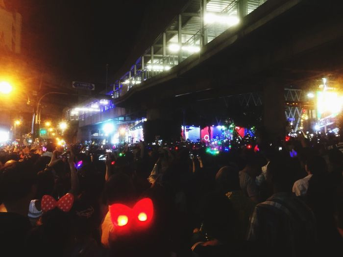 Crowd at music concert in city at night