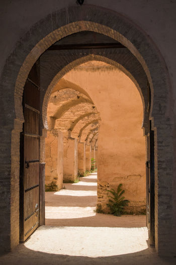 Absence Ancient Ancient Civilization Arcade Arch Architectural Column Architecture Building Built Structure Colonnade Corridor Courtyard  Day Entrance History Indoors  Nature No People Shadow Sunlight The Past The Way Forward