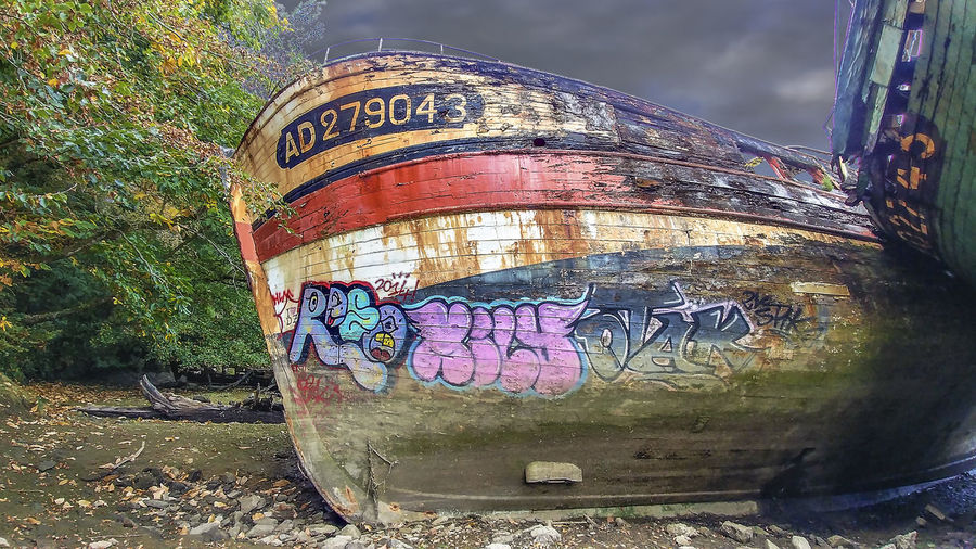 Ship Wreck Text Communication Plant Day Western Script Graffiti Tree No People Art And Craft Nature Creativity Close-up Container Outdoors Metal Cylinder Barrel Representation Abandoned Old Message