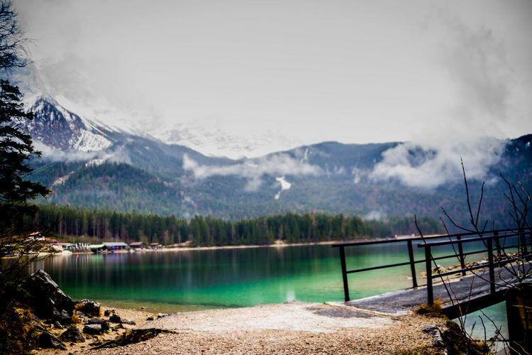 Mountain Scenics - Nature Beauty In Nature Water Sky Lake Tranquil Scene Tranquility Mountain Range Nature Non-urban Scene No People Day Idyllic Landscape Tree Environment Cloud - Sky Outdoors Snowcapped Mountain Mountain Peak