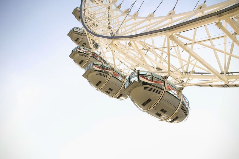 Low Angle View Ferris Wheel Amusement Park Sky Arts Culture And Entertainment Amusement Park Ride Clear Sky Leisure Activity Fun Day Outdoors No People Big Wheel Chain Swing Ride London London Lifestyle Theeye