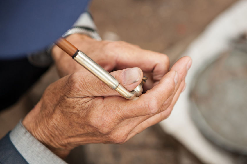 Man Smoking Tobacco Adult Body Part China Chinese Close-up Hand High Angle View Holding Human Body Part Human Hand Human Limb Lifestyles Men One Person Pipe Real People Senior Adult Smoking - Activity Smoking A Pipe Smoking Kills Smoking Man Wrinkled