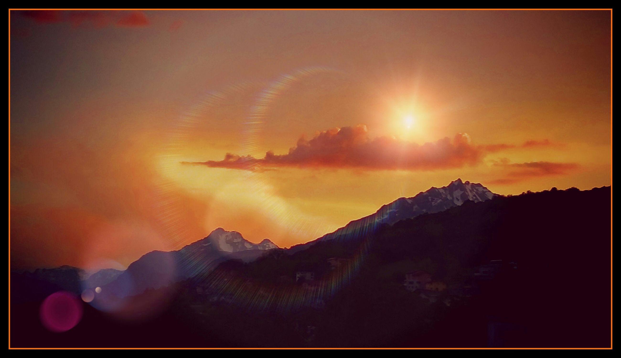 transfer print, sunset, auto post production filter, scenics, beauty in nature, sky, tranquil scene, sun, orange color, mountain, tranquility, nature, idyllic, cloud - sky, sunlight, outdoors, no people, mountain range, cloud, sunbeam