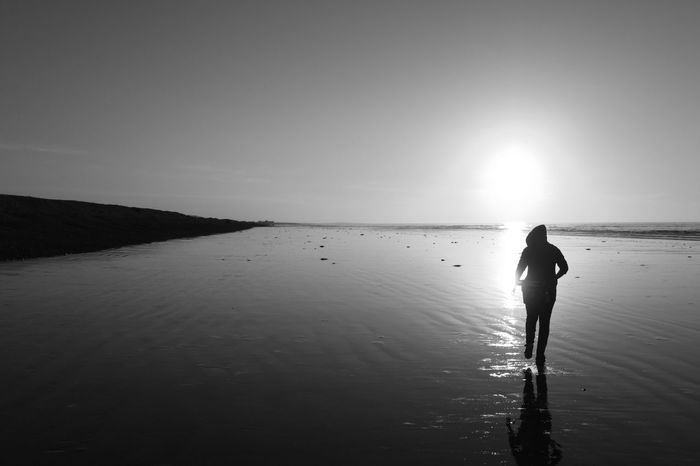 Silhouette on sandy Scottish beach. EyeEmNewHere Scotland Beach Blackandwhite Coast Day Horizon Over Water Nature One Person Outdoors People Reflection Sand Scenics Sea Silhouette Sky Standing Sunlight Tide Out Tourism Tranquil Scene Tranquility Vacations Water