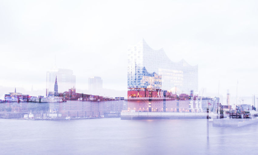 Commercial dock by river against buildings in city