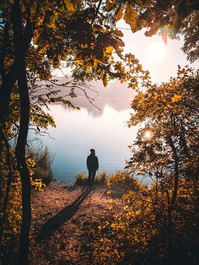 Man standing in front of lake