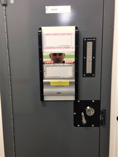 One Person Indoors  Real People Police Custody Prisoner Police Cell Police Detainee Technology Lifestyles Photography Themes Portrait Women Communication Machinery Mirror Adult Females Connection Leisure Activity Portable Information Device Front View Looking Lock Up Locked Up