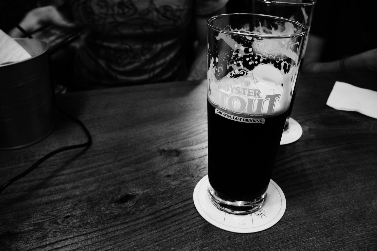 drink, refreshment, food and drink, table, drinking glass, freshness, indoors, beer glass, alcohol, focus on foreground, beer, close-up, frothy drink, no people, day