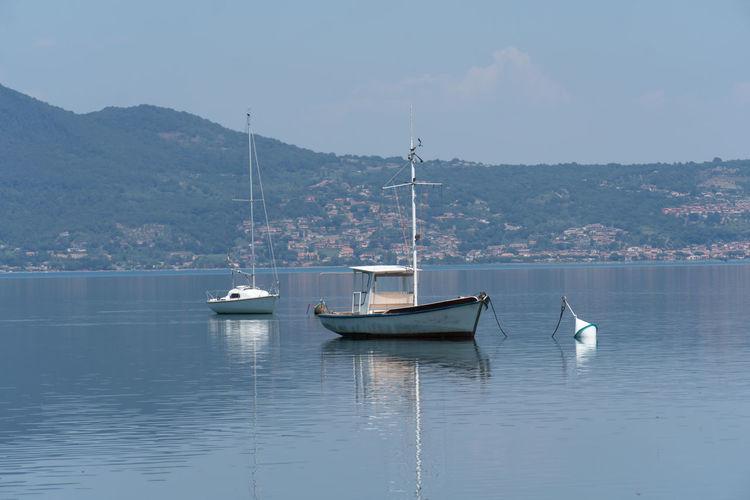 Sailboats Sailing On Lake Against Sky