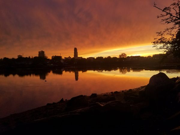 A perfect end to a stormy day!! Sunset photo taken at Five Islands Park, New Rochelle on May 15th, 2018. Urban Skyline Tree Water Sunset Silhouette Reflection Beauty Standing Water Calm Romantic Sky Shining