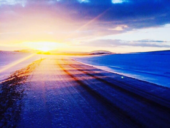What a magical place Scenics Nature Beauty In Nature Tranquil Scene Sky Sunset Tranquility No People Outdoors Road Day Snow Road Peace Alaska Rays Of Light EyeEmNewHere Let's Go. Together.