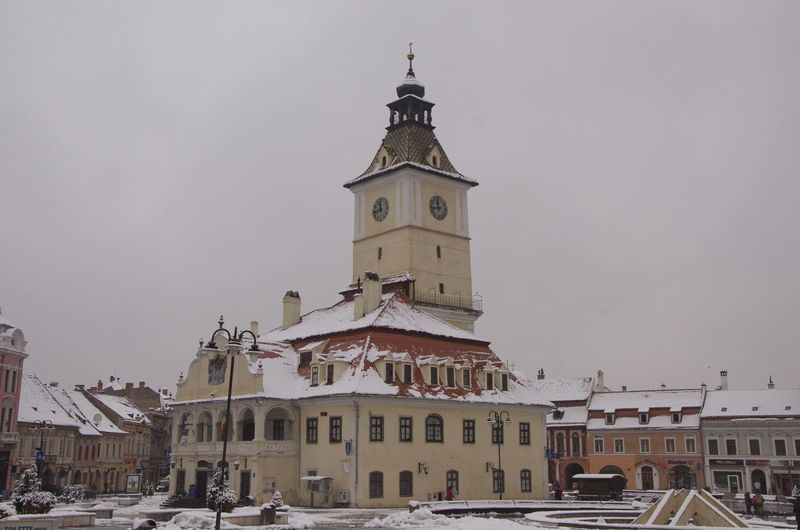 Historic building in town against sky during winter