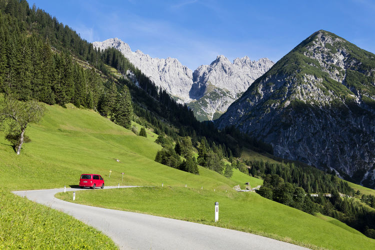 Alps, alpine village in the valley, Gramais, Austrian Car Activity Alps Austrian Alps Beautiful Nature Beauty In Nature Blue Day Driving Extreme Grass Green Color Landscape Mountain Nature No People Outdoors Resort Rock Scene Sunny Terrain Travel Tree View