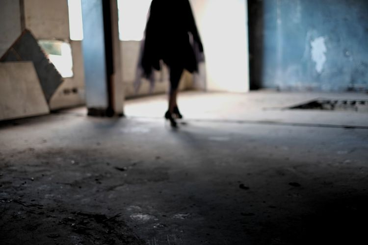 Low section of woman walking outdoors