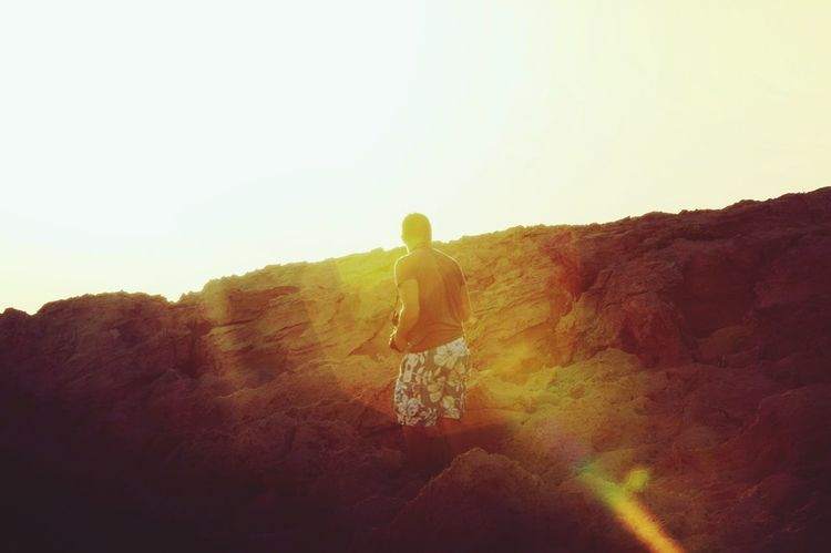 Full Length One Person Sunlight Rear View Sunset Landscape Adults Only Young Adult People Outdoors Adult Nature Day Solar Flare
