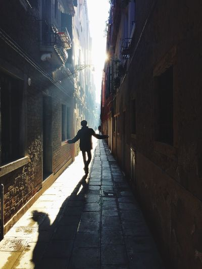 Architecture Walking Sunlight Real People One Person Silhouette City