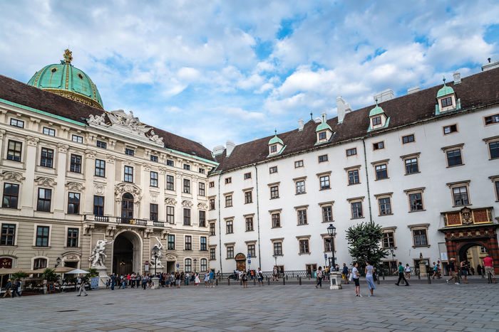 Courtyard in Hofburg Palace of Vienna Hofburg Hofburg Vienna Imperial Palace Architecture Austrian Building Building Exterior Buildings Built Structure City Courtyard  Day Imperial Treasures Landmark Large Group Of People Outdoors Palace People Royal Palace Sky Travel Destination Travel Destinations Visit