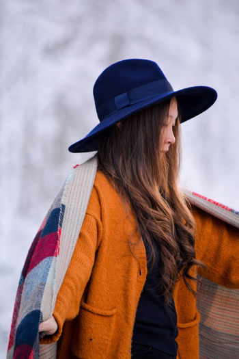 Close-up of woman wearing hat against sky