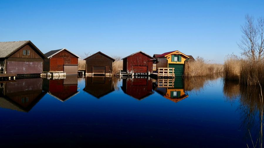 Neusiedler See Water Reflection Architecture Built Structure Building Sky Building Exterior House Waterfront No People Blue Nature Clear Sky Lake Copy Space Day Symmetry Row House