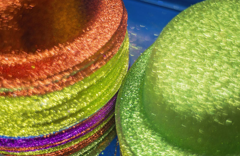 Blurred Motion Hats Stacked Green Color Neon Colors Colorful Pattern Close-up No People Selective Focus High Angle View Full Frame