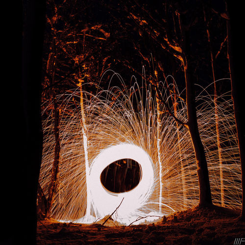 Night Illuminated Wire Wool Long Exposure Glowing Tree Blurred Motion Circle Motion Sparks Geometric Shape Light Painting Nature No People Outdoors Shape Communication Spinning Land Celebration