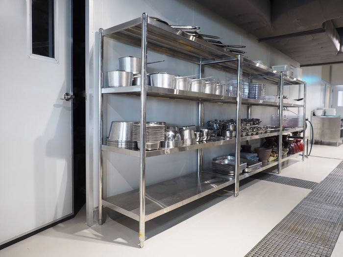 Stainless steel shelf with kitchen utensils in a corner of kitchen EyeEm Selects Indoors  Architecture No People Built Structure Shelf Metal Flooring Wall - Building Feature Building Pipe - Tube Industry Kitchen Safety Rack Large Group Of Objects