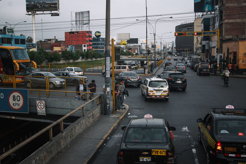 The streets of Peru's capital. Transportation Mode Of Transportation Land Vehicle Street Travel Travel Destinations Motor Vehicle Motorcycle Urban City City Life Car City Street Public Transportation Incidental People Motion Outdoors Busy Bus Built Structure Traffic Jam Traffic Architecture Building Exterior Road