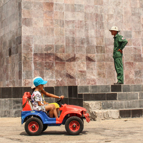 kids driving car in fron of policeman ASIA Asian  Boy Car Child Children Concept Day Drive Driving Driving Licence Kids Man Multi Colored Outdoors Police Policeman Safety Safety First! Street Streetphotography Traffic Traffic Rules Vehicle