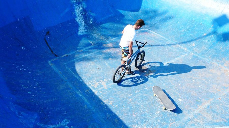 Man With Bmx Bike At Bottom Of Sports Ramp