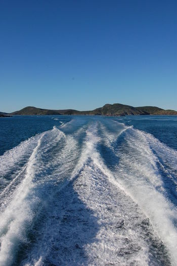 Heading back to the mainland after a day at the great barrier reef. Queensland. Australia Clear Sky Sky Blue Water Scenics - Nature No People Day Nature Beauty In Nature Environment Sea Tranquil Scene Mountain Outdoors Tranquility Land Winter Wake - Water Great Barrier Reef Queensland Australia