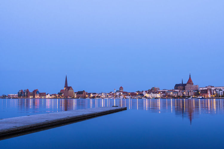 View over the river Warnow to Rostock, Germany. City Lights Relaxing Rostock Sky And Clouds Travel Building Exterior Buildings Built Structure Cloud - Sky Evening Journey Landing Stage Night No People Outdoors River Sky Tourism Town Travel Destinations Vacation Warnow Water Waterfront