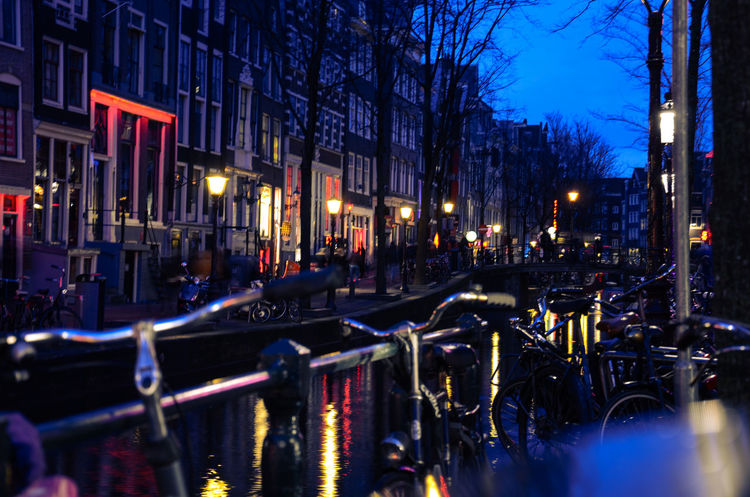 Amsterdam Canal in January. Amsterdam Amsterdam Canal Amsterdam Centraal Amsterdamcity Architecture Bike Bridge Building Exterior Built Structure Canal City Illuminated Land Vehicle Neon Lights Night Nightlife No People Outdoors Red Light District Reflection River Riverside Sky Transportation View