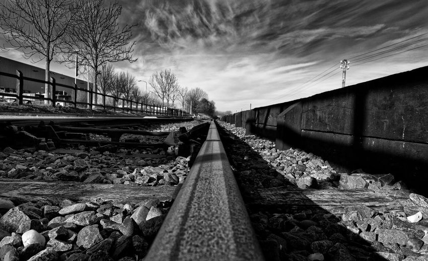 On Track Architecture Bare Tree Bridge - Man Made Structure Building Exterior Built Structure Cloud - Sky Day No People Outdoors Rail Transportation Railroad Track Sky Transportation