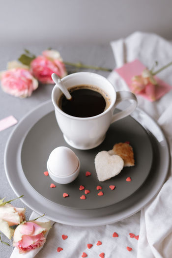 High angle view of coffee and cup on table
