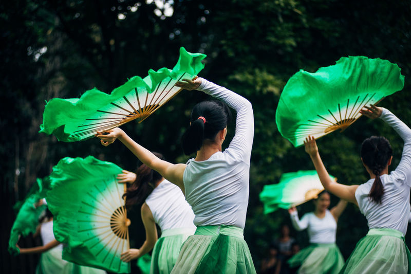 Girls Performing With Green Hand Fans