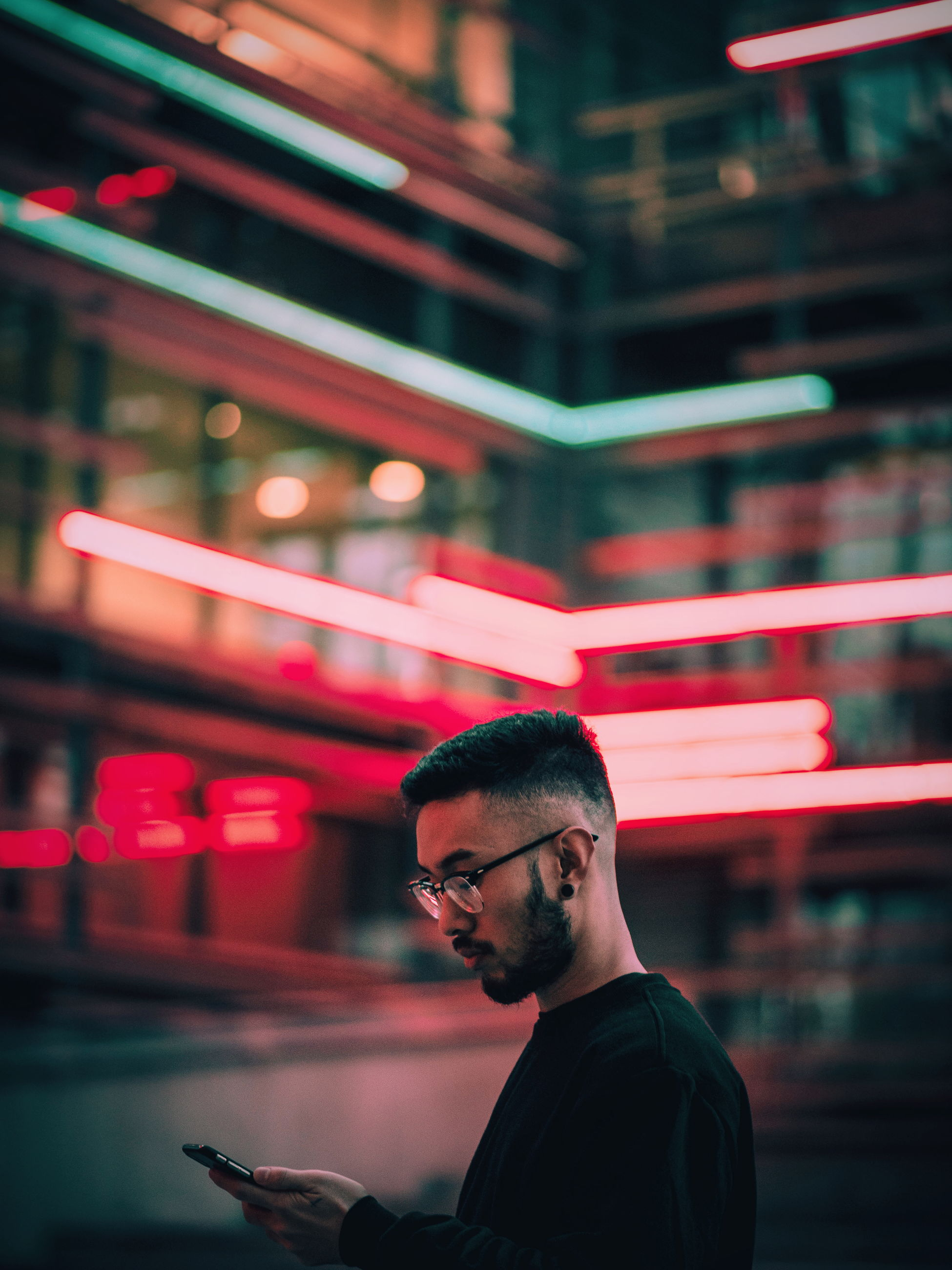 one person, real people, young adult, eyeglasses, illuminated, young men, focus on foreground, technology, lifestyles, wireless technology, night, indoors, people