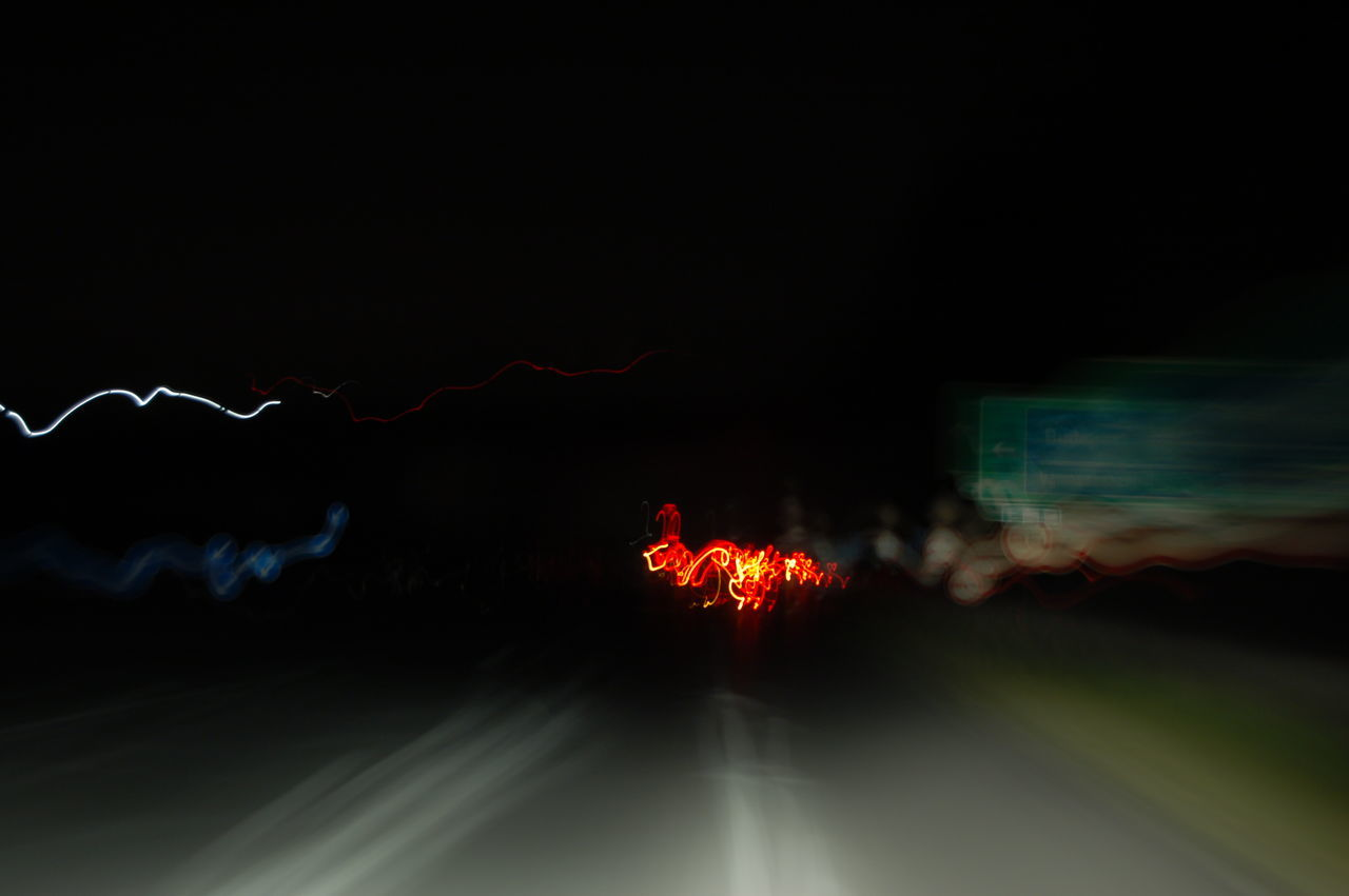 night, illuminated, glowing, motion, long exposure, blurred motion, outdoors, no people, burning, nature, sky, defocused, power in nature