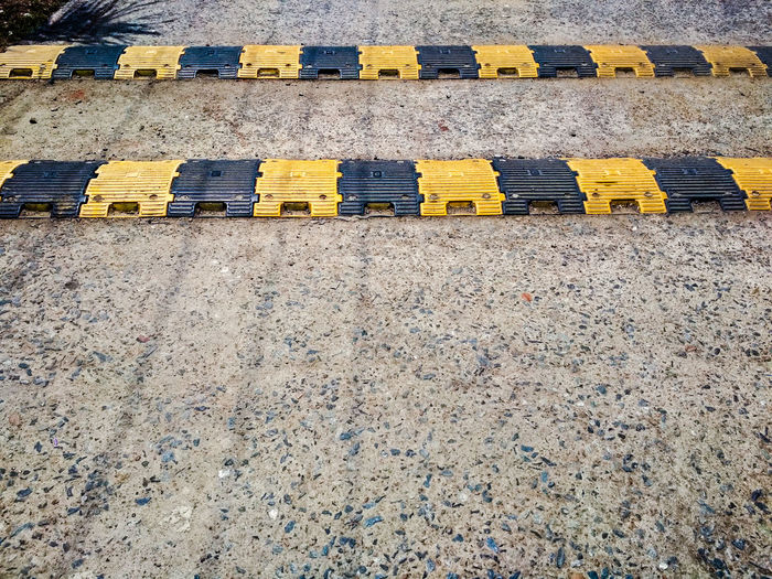 Speed Breaker Urban India Travel Design Breakers Speed Control Transportation Road Structure Pattern Abstract Architecture Copy Space Outdoors Yellow Close-up LINE Parallel Roadways Marking Ground Textured  Architectural Design Yellow Line Vehicle