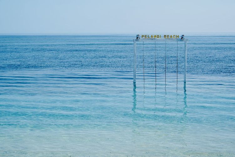 Gate Holiday Beach Beauty In Nature Blue Clear Sky Day Horizon Horizon Over Water Idyllic Land Nature No People Outdoors Paradise Rippled Scenics - Nature Sea Sky Swing Tranquil Scene Tranquility Turquoise Colored Water Waterfront The Great Outdoors - 2018 EyeEm Awards The Traveler - 2018 EyeEm Awards